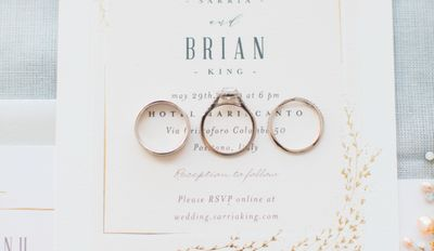 Wedding rings laid out on stationary
