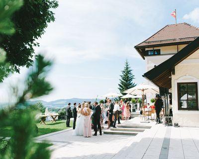 Outdoor wedding reception in a mountain resort venue in Austria