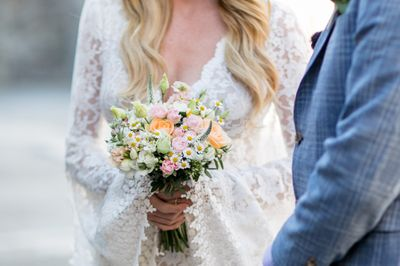 Pale wildflower bridal bouquet with dasies