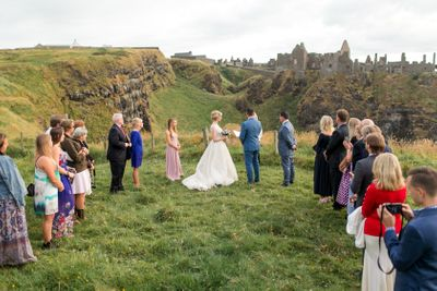Small wedding ceremony at Dunluce Castle in Northern Ireland