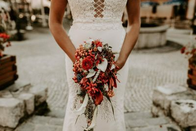 Orange waterfall bridal bouquet for a wedding in Germany