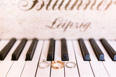 Weddings rings laid on top of Leipzig pianos keys